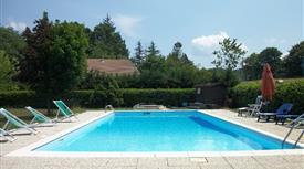 Graziosa villettina a schiera con piscina e giardino