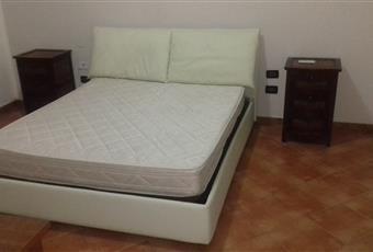 Camera da letto con letto Chateau d'Ax.Il pavimento è piastrellato, il pavimento è di parquet Sicilia TP Marsala