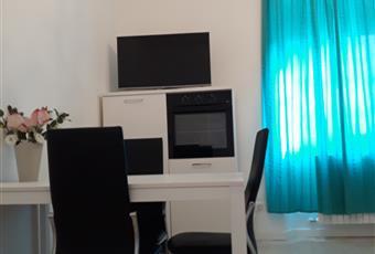 La stanza è molto grande luminosa e con soffitto alto, super accessoriata. Abitabile con divanetto e tv : una cucina soggiorno Marche FM Fermo