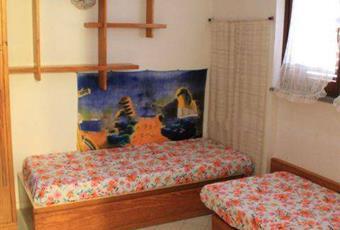 La camera è luminosa, il pavimento è piastrellato Sardegna CA Pula