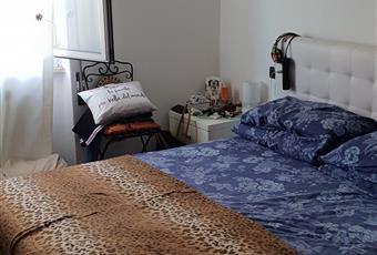 La camera è luminosa, il pavimento è di parquet Liguria SP La Spezia