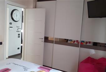 La camera è ampia e luminosa, dotata di una piccola cabina armadio Valle d'Aosta AO Fenis