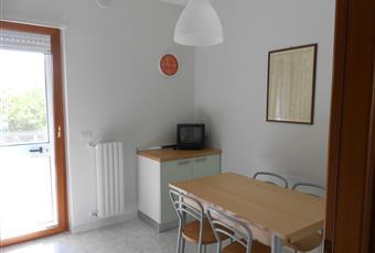 Cucina abitabile con porta finestra su balcone coperto Basilicata MT Matera