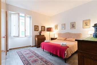 La camera è luminosa ampia dotatat di comodossimo armadio a parete  Toscana FI Firenze
