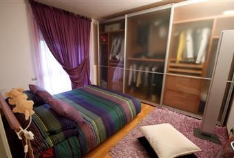 La camera è luminosa con terrazzo e tenda. Marche FM Porto Sant'Elpidio
