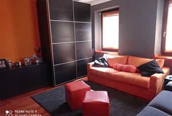 """Il pavimento è di parquet, il salone è luminoso, le pareti esposte hanno cappotto interno. è adibita a """"sala TV"""" ma può essere usata per ricavare una terza camera ampia regolare di 18mq  Veneto BL Domegge di Cadore"""