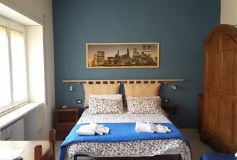 Battistini Gemelli luminosa camera con bagno e uso cucina con altra stanza