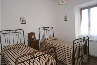 Camera con 2 letti singoli e mobili antichi Toscana GR Roccastrada