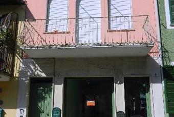 Appartamento bilocale+ locale commerciale