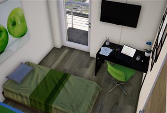 La stanza singola è molto spaziosa con la possibilità di acceder ad un balcone  Piemonte CN Vignolo