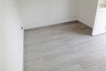 Il pavimento è di parquet Toscana LI Piombino