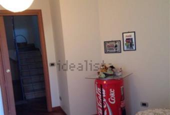 La camera è luminosa, con soffitto alto, il pavimento è di parquet Sicilia AG Licata