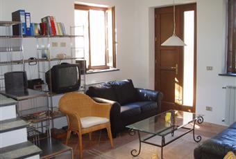 Mary2: salotto adiacente alla cucina, luminoso, pavimenti in gres, accogliente Toscana LU Massarosa