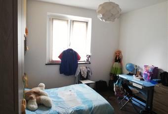 La camera è luminosa, il pavimento è di parquet Piemonte VB Villette