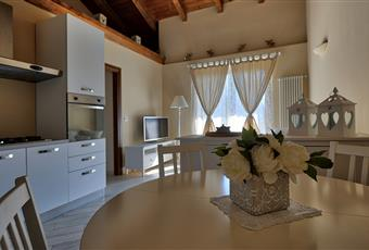 Il salone è luminoso con travi a vista e soppalco  Valle d'Aosta AO Fontainemore