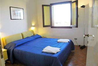 La camera è luminosa, il pavimento è piastrellato Sardegna SS Olbia