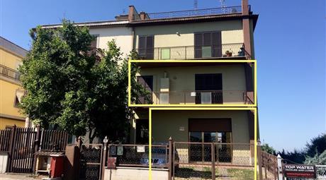 Appartamento 100 mq con locale 85mq e giardino